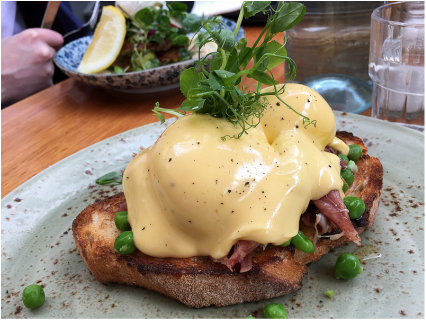 Eggs Benedict on rustic bread